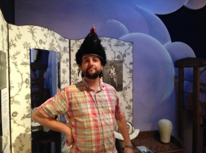 Aaron wearing a replica of Alfred's rooster hat.